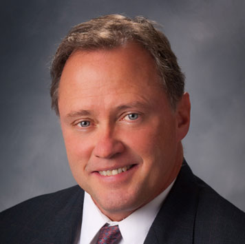 Mark T. McCue, CFI
